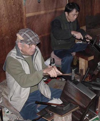 Mr. Shunsaku Kanzawa, Master Saw Maker, and a Journeyman Saw Maker